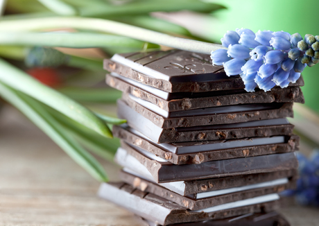 Decorative Stack of Chocolate on wooden board with flower